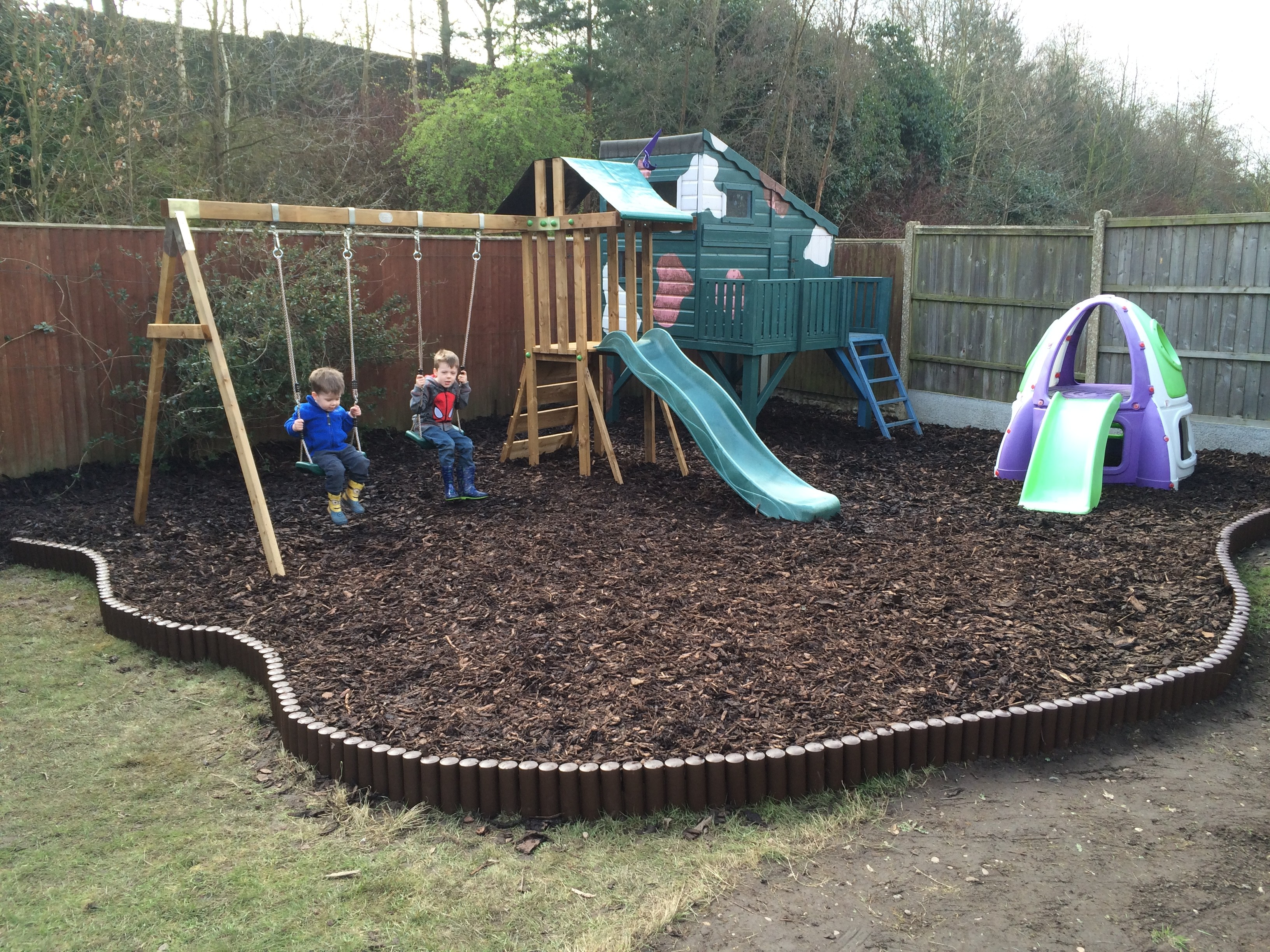 Climbing Frame from Dunster House with two swings and a slide