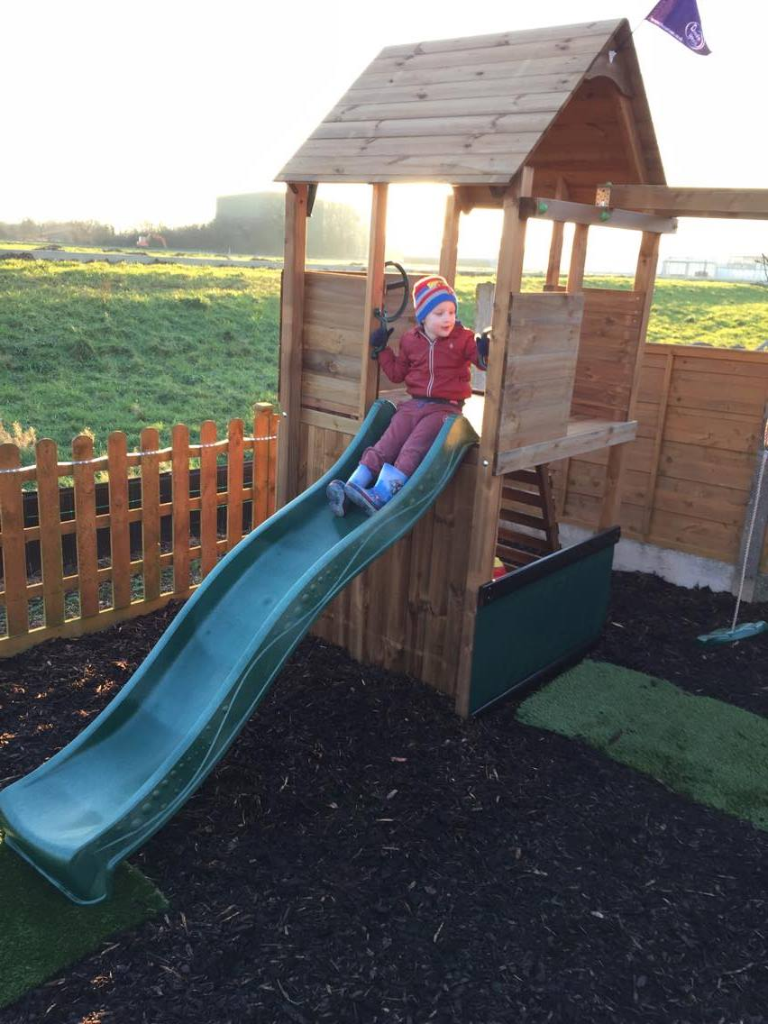 Climbing Frame from Dunster House with kid on the slide