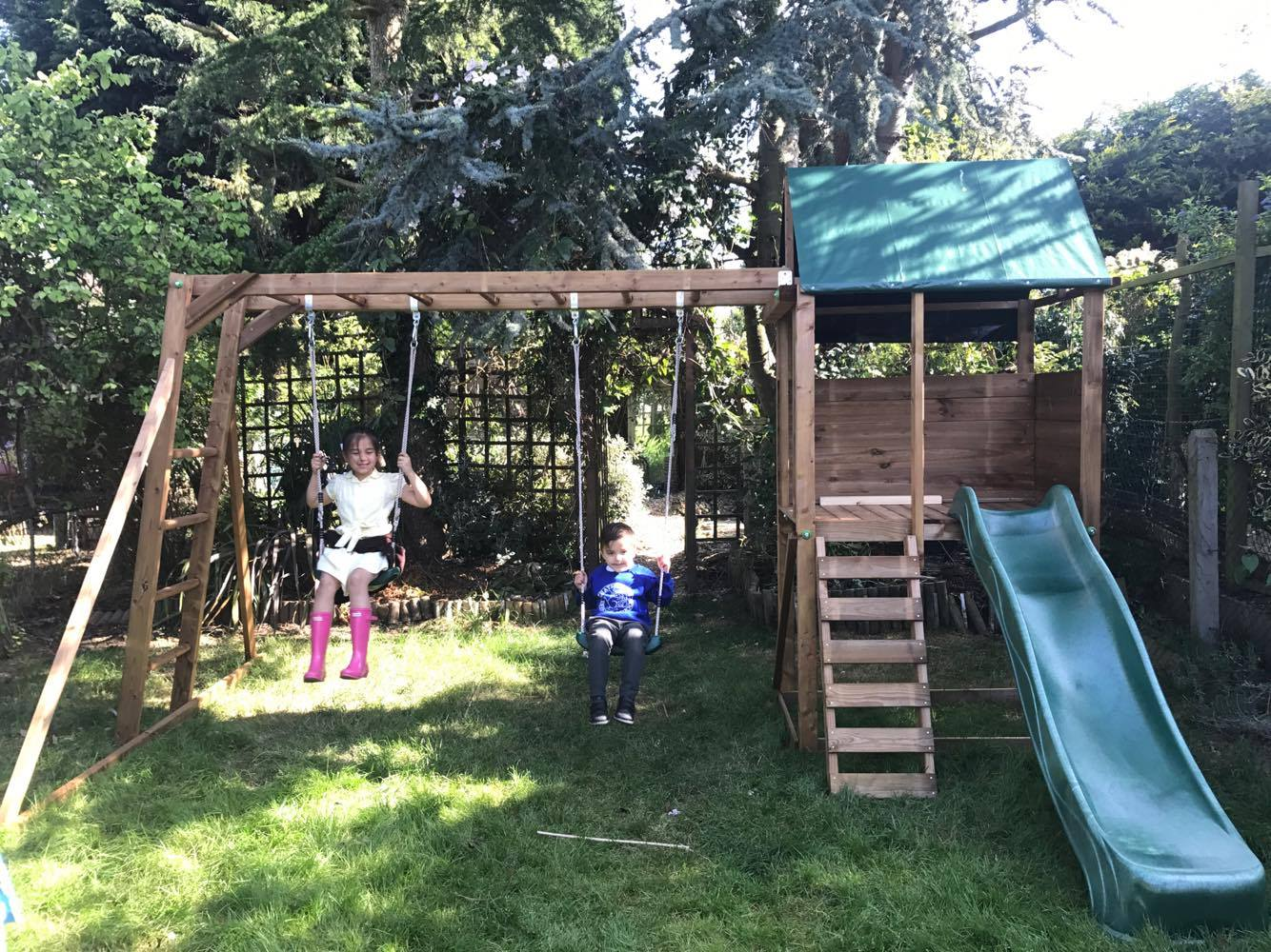 Climbing Frame from Dunster House with kids swinging