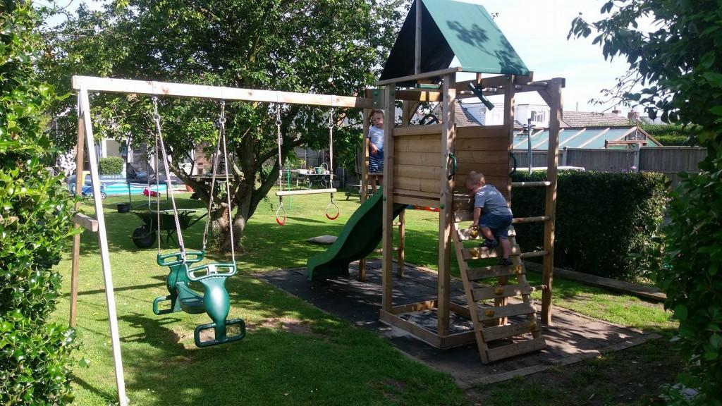 Children playing on climbing frame